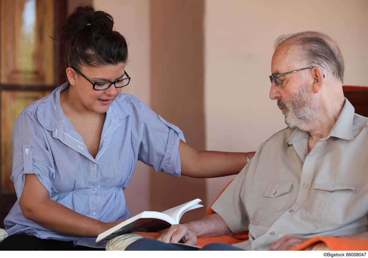 Caregiver reading to a senior